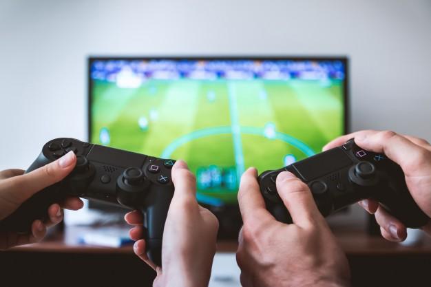 Mando de PS con juego de futbol